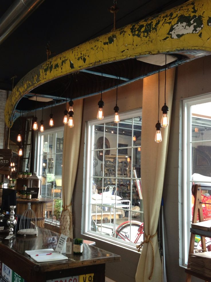 Cool canoe with lights. Love and want for under the deck!!  Elm & Iron, Columbus, Ohio.