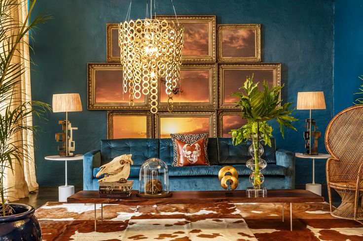 Beautiful, eclectic & dramatic interior with brass Surilight chandelier.