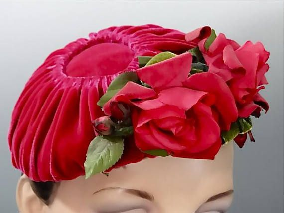 1950s hot pink velvet fascinator hat with matching silk roses and flower posies - Bonwit Teller Philadelphia. In 1911, Paul J. Bonwit and Edmund D. Teller opened their high quality ladies apparel store located on 5th Avenue, New York (Vintage Fashion Guild). The 5th Avenue store was their flagship location. The condition of the hat is great with very little signs of age or use. I do not see any notable blemishes to list; the hat has been well preserved and possibly never worn. Refer to the…