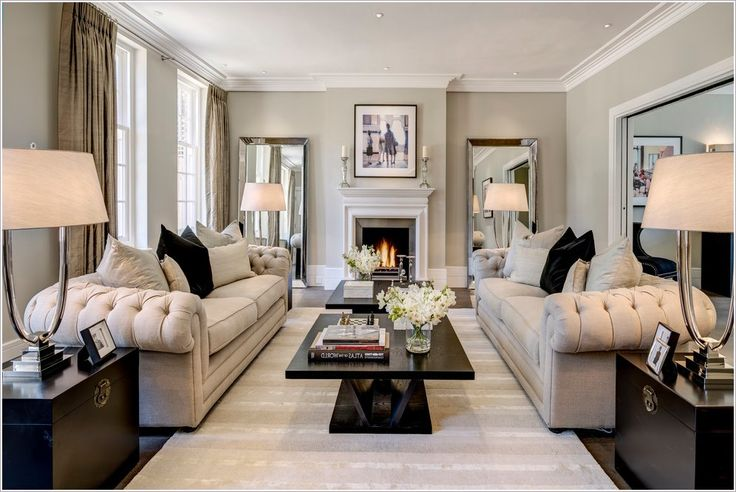 Living Room Transitional London black coffee table black pillows candle holders candles chesterfield sofa classical coffee table contemporary design dressing Fireplace interior large mirrors light gray sofa light gray wa id-2027 | Amazing Renovation Guides Amazing Renovation Guides