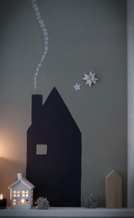 Weihnachtsstadt unter`m Sternenhimmel.  ...der aufsteigende rauch des hauses gibt die tage bis weihnachten an.
