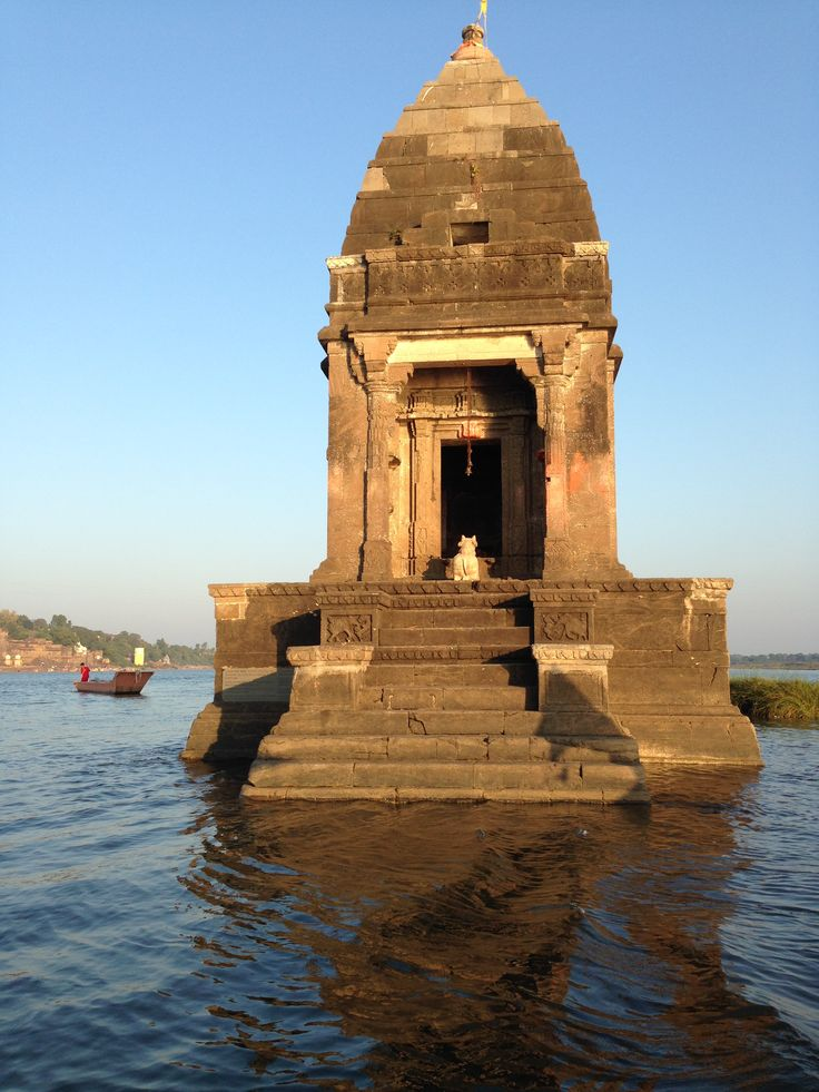 Shiv temple in the middle or Narmada at Maheshwar