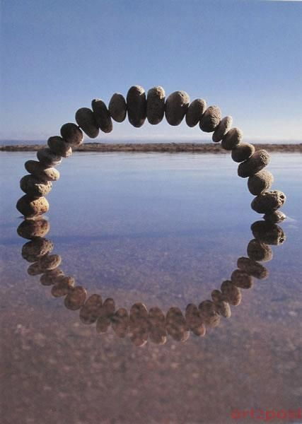 Balance - This shows balance because of the arc of pebbles in the top half, which reflects to make another arc in the bottom half. Thus, it makes a balanced circle.