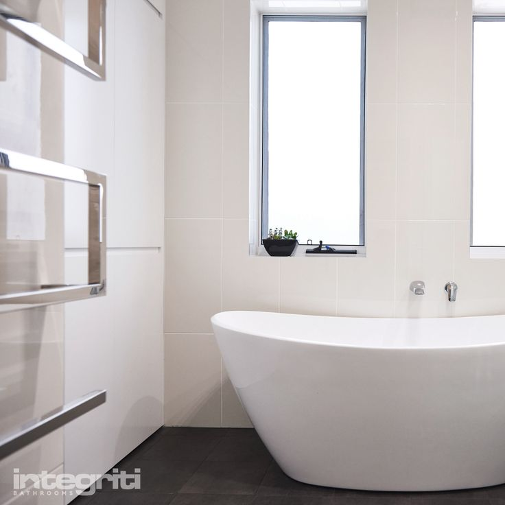 A great space for this bathtub just under two tall windows. As we've mentioned before, placement of your bathtub is crucial to creating comfort in your bathroom so always consider lighting and other details in the surrounding space. #integritibathrooms #custommade #sydneybathroom #interiordesign #bathroom #bathtub #windows #bathroomremodel #bathroomrenovation