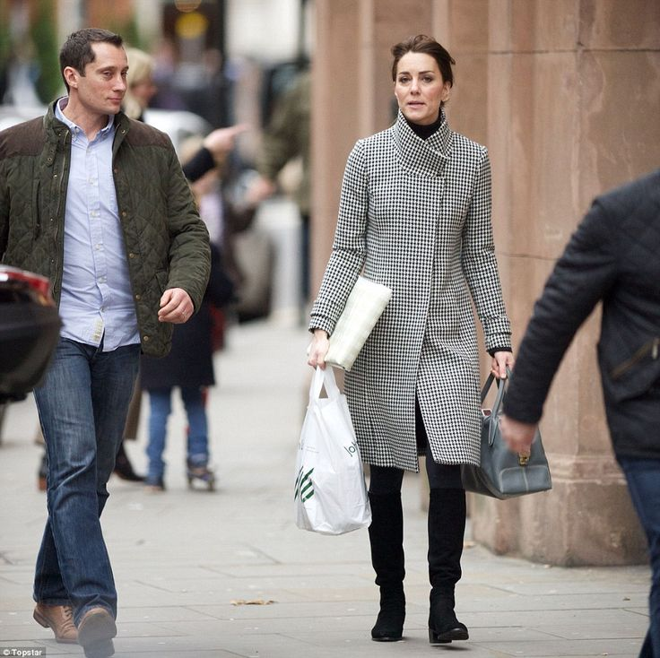 Christmas shopping: The Duchess of Cambridge wrapped up in a sophisticated houndstooth coat as she stepped out in London on Friday