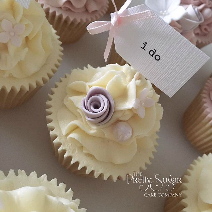 Wedding cupcakes with 'I do' cupcake picks and sugar roses and blossoms