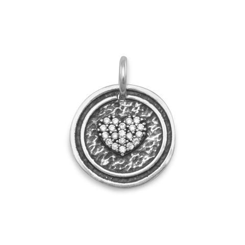 Oxidized Round CZ Heart Pendant $32.99 www.aweddingoutlet.com Round oxidized sterling silver pendant with CZ heart design. The pendant is 17mm. The pendant hangs 23mm.