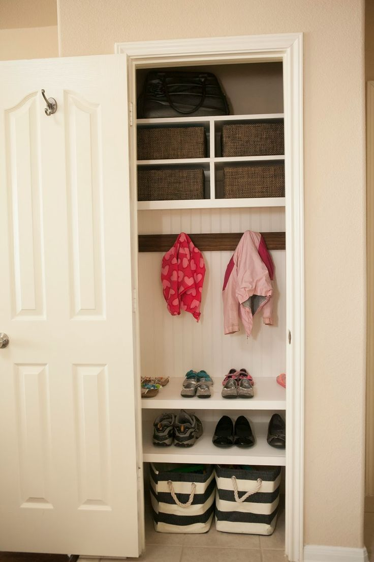 This coat closet makeover is giving me ideas for our coat closet. I love how this uses more of the space than the typical shelf and rod that we have in ours. | www.mybellabug.blogspot.com