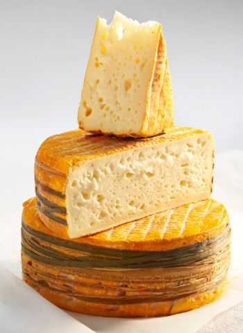 Livarot French Cheese .......... region : Normandy ....milk : cow ... Love the way they are at the wood around the base of the cheese...