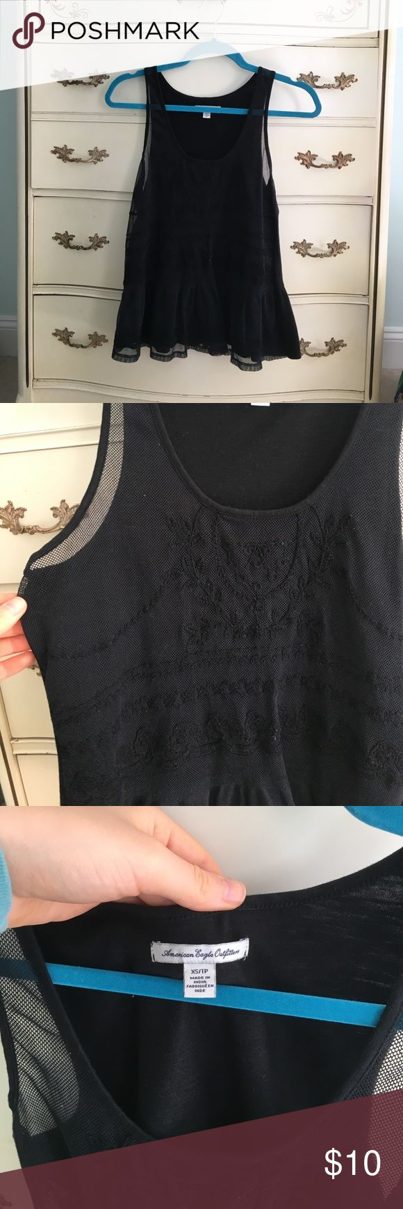 American Eagle Black Peplum Top Front has a woven floral design and the back is solid black. Very cute, i just never wear it anymore! size xs American Eagle Outfitters Tops Tank Tops