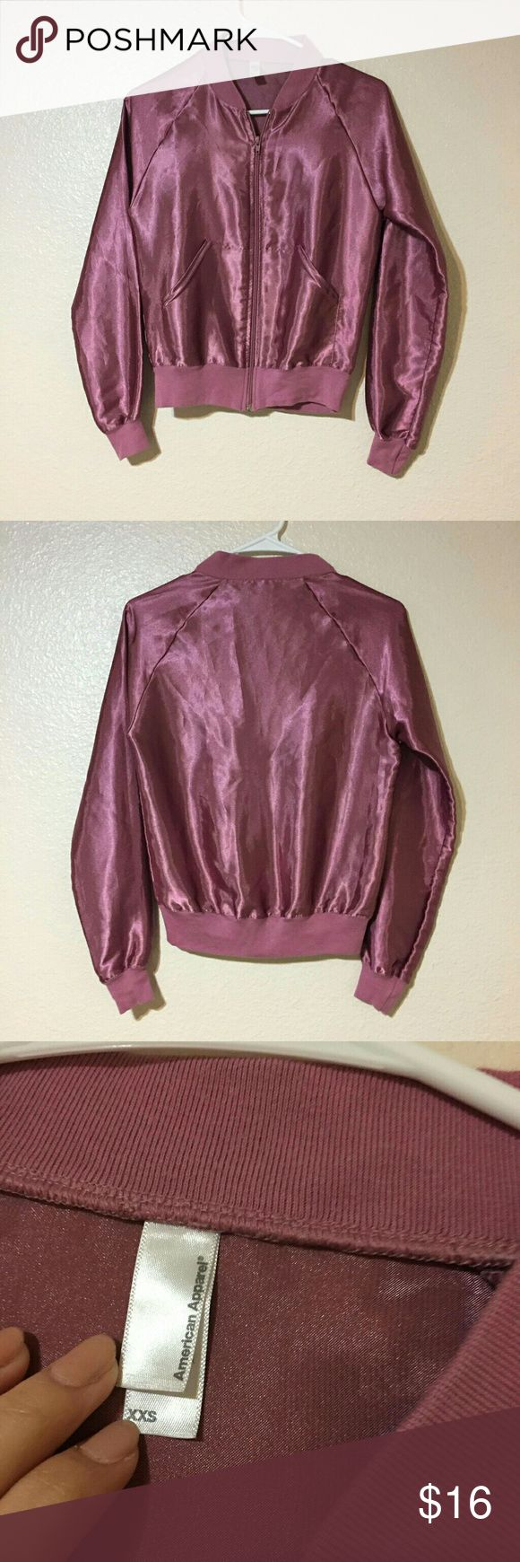 American Apparel satin bomber American Apparel light purple silky bomber jacket. Great condition, but it does have a few snags that are not noticeable when worn. Fits an xs perfectly. American Apparel Jackets & Coats