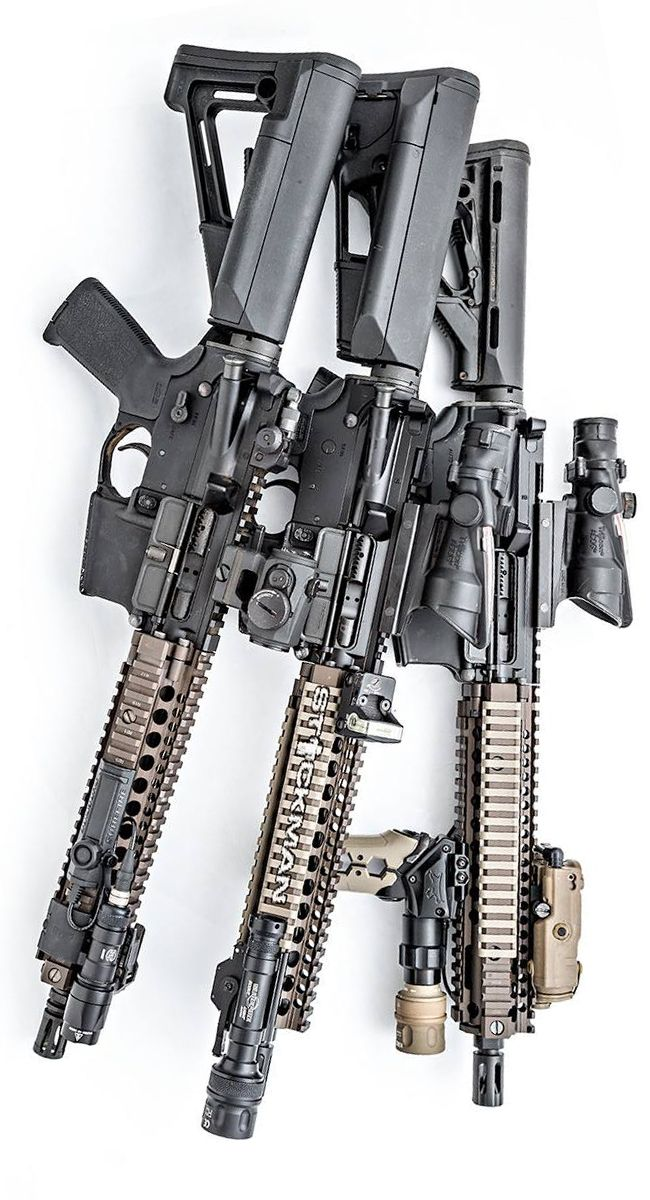 Daniel Defense rifles, Magpul attire, SureFires, Aimpoint, and Trijicons. Photo by Stickman.