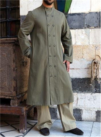SHUKR UK | Munir Jubba  Hits below knee Mandarin collar with button closure 2 rows of buttons down the front 2 side slit pockets with single welt
