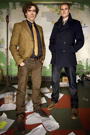 Dirk Gently. Image shows from L to R: Dirk Gently (Stephen Mangan), Richard MacDuff (Darren Boyd). Image credit: ITV Studios.