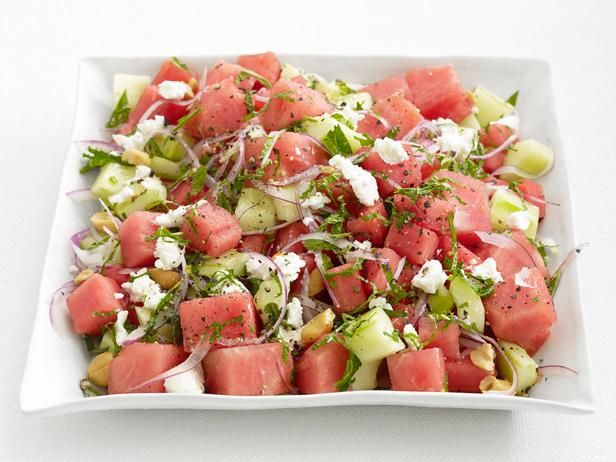 Watermelon Cucumber Salad : Juicy watermelon is the star of this savory salad. Toss it with crispy cucumbers, sliced onion and creamy goat cheese. Soak the red onion in cold water for 10 minutes for a more subtle onion flavor.