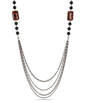 Capture earthly glamour with this stand-out necklace. Polished beads of moody onyx and suspended layers of gunmetal chains expertly blend organic chic and modern appeal.