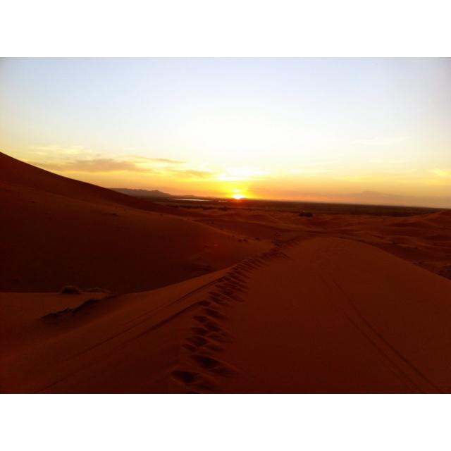 Sunset in the Sahara. Slept under the stars in the desert last night.