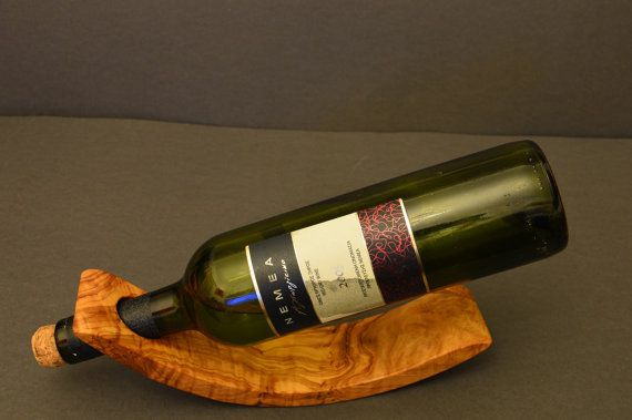 Hey, I found this really awesome Etsy listing at https://www.etsy.com/listing/492374098/handmade-olive-wood-wine-bottle-holder