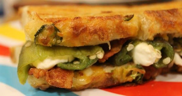 Outrageous Jalapeno Popper Grilled Cheese // This grilled cheese is outrageously good with its cream cheese stuffed jalapenos, bacon, and cheese on jalapeno cheese bread