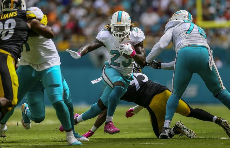 Steelers vs. Dolphins:     October 16, 2016  -  30-15, Dolphins  -      Miami Dolphins running back Jay Ajayi (23), runs for a first down agains the Pittsburgh Steelers during their NFL game Sunday October 15, 2016 at Hard Rock Stadium in Miami Gardens. (Bill Ingram / The Palm Beach Post)