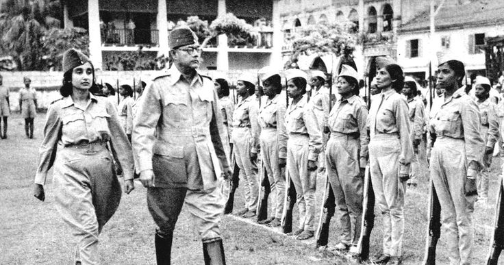 Chandra Bose and Lakshmi Sahgal, the Minister of Women's Affairs in the Azad Hind government. Bose is seen here reviewing an Indian National Army female combat regiment -- one of world's first.