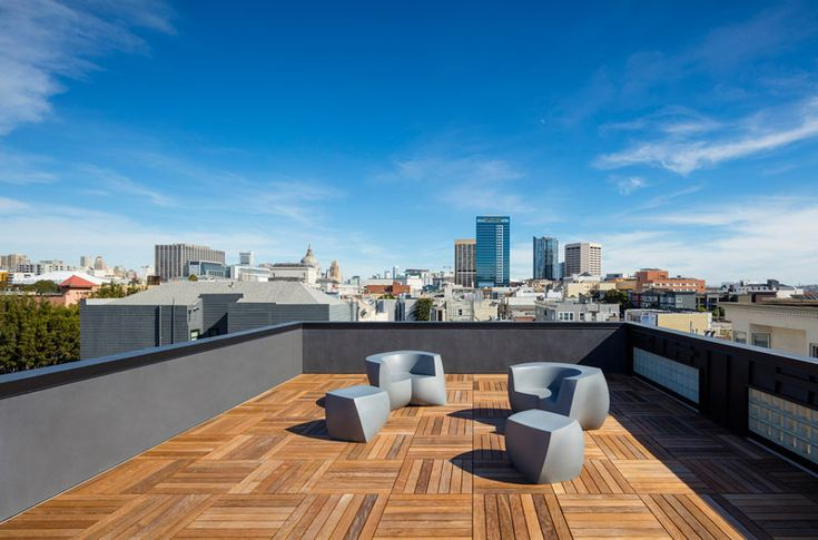 This rooftop has wooden flooring and views of San Francisco.