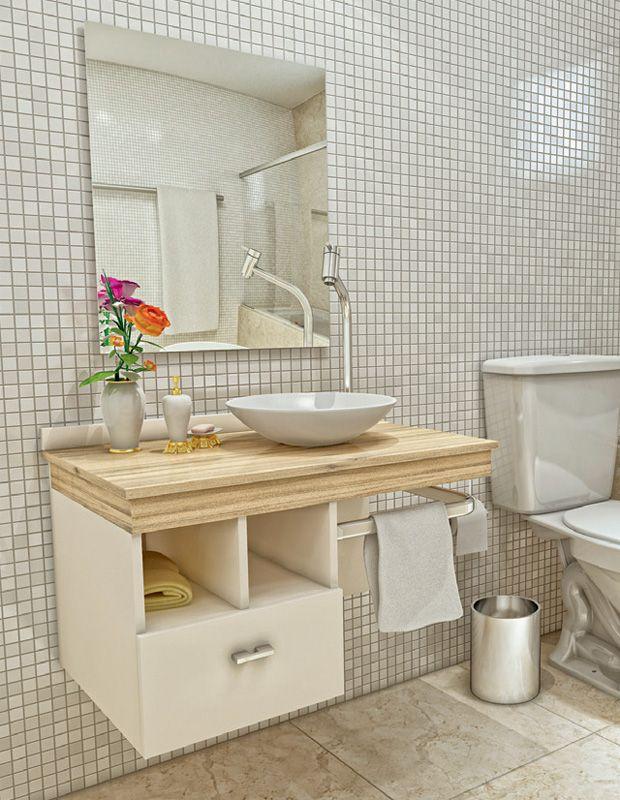 O kit adhara, da vtec, oferece espelho, frontão, cuba de apoio, tampo e gabinete com toalheiro, dois nichos abertos e gaveta com puxador de alumínio. O tampo de mdF (70 x 44 x 7 cm*) – já furado para receber uma torneira de mesa – é preso ao móvel (40 x 44 x 45 cm) de mesmo material, revestido de laminado branco texturizado fosco. A cuba de resina de poliéster tem 32 cm de diâmetro. Conjunto Walmart, 12 x R$ 80,82
