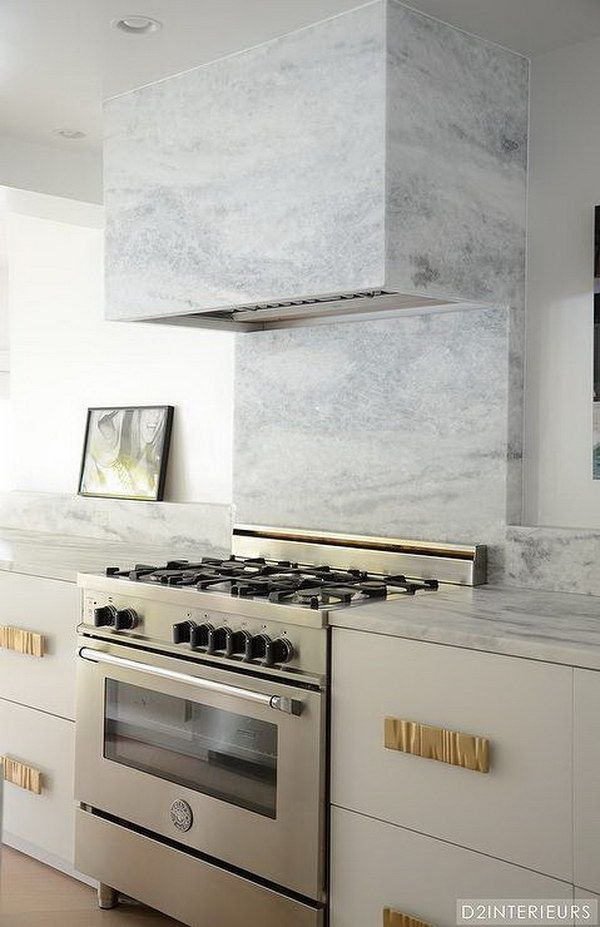 Grey Marble Backsplash and a Gray Marble Vent Hood