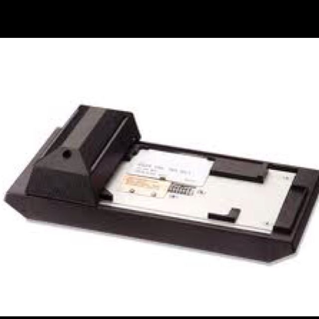 Credit card swiper. Used one of these at my first job. Had to look for bad credit cards in a little paper book with thousands of numbers! New ones came out every month!
