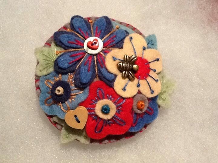 Handmade floral felt brooch with bee and bead embellishments, lavender scented.