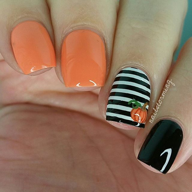 "Tiiiiny pumpkin!  Full video with voiceover is up on my YouTube channel - link in bio!  - Loosely inspired by /amkuch15/'s famous stripes and accent heart mani! - Products used:  Striping tape: ebay White: ""Alpine Snow"" OPI Black: ""Black Onyx: OPI Orange: ""Where Did Suzi's Man-go?"" OPI Top coat: HK girl /glistenandglow1/"
