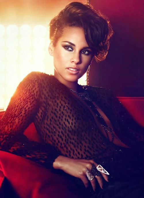 Alicia Keys: Looks like a girl, but she's a flame  So bright she can burn your eyes  She's on top of the world  Everybody stands as she goes by  Cause they can see the flame that's in her eyes  She's lighting up the night  This girl is on fire