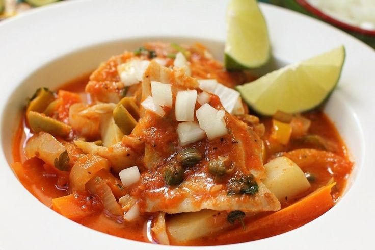 Mexican Fish Veracruz with onion and lime wedges, dried marjoram, capers, potatoes, bell pepper, tomatoes