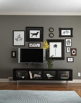 i like the gray wall with black and white accents. but it needs 'some' color, no?