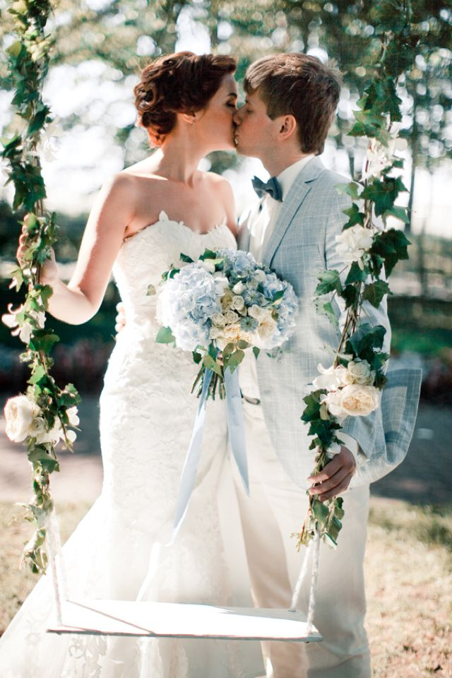 Kissing by the swing | Anastasiya Belik Photography | http://burnettsboards.com/2013/12/powder-blue-white-wedding/