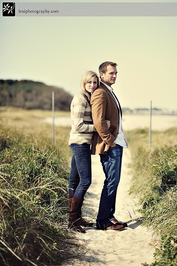 sweater jeans and tall boots for her. Jeans, print shirt, and brown blazer for him