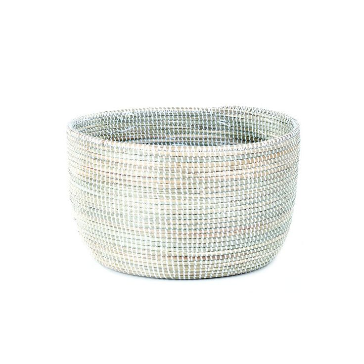 """Store in style with the white storage basket. Toss your favorite throws in it or tuck away toys. Perfect for the tabletop or floor in any room. • 18""""L x 10""""W x 11""""H • Handmade in Senegal, Africa • Cra"""