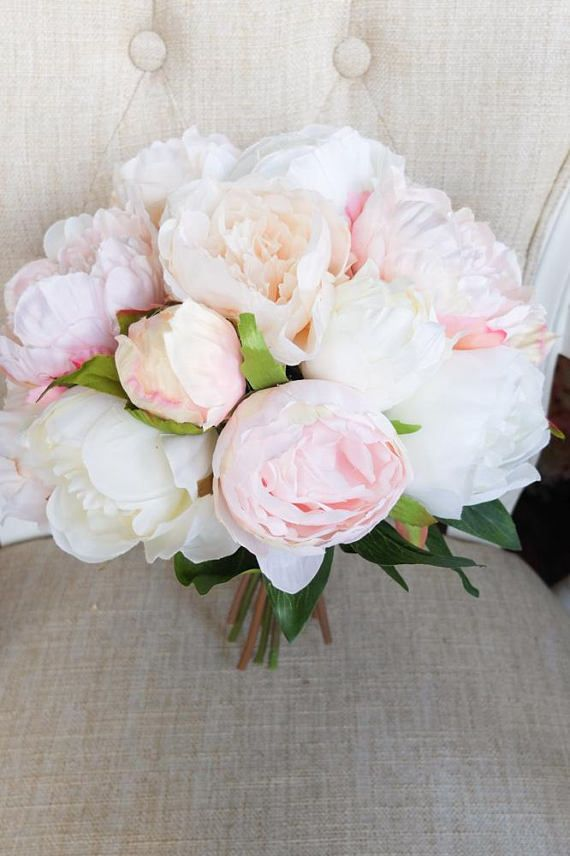 Silk wedding bouquet in a mix of blush pink, ivory and pale peach. Made with artificial peonies and subtle greenery. This bouquet is available in 3 different sizes, - bridal (10 inch), bridesmaids (7-8inch) and flower girl (5inch). Images show bridal bouquet size. The stems of the