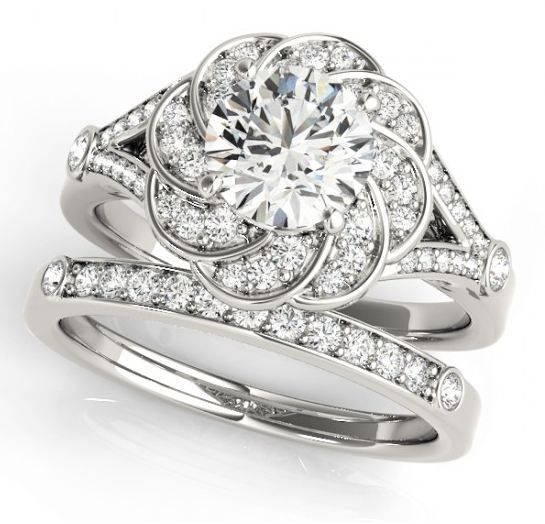 You imagine. We design. Check out Linara's Engagement Ring Collection. Style# 51045-E - Round Diamond Flower Engagement Ring.