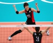 Saori Kimura #18 and Yoshie Takeshita #3 of Japan celebrate a point in the second set against Dominican Republic during Women's Volleyball on Day 5 of the London 2012 Olympic Games at Earls Court on August 1, 2012 in London, England. - http://www.PaulFDavis.com/success-speaker (info@PaulFDavis.com)