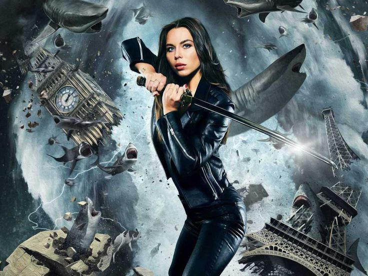 """Liliana Nova spielt im fünften Teil der Kult-Trash-Reihe """"Sharknado"""" mit. Das erste Foto zeigt sie im sexy Leder-Outfit samt Schwert in der Hand… In diesem Sommer fliegen die Haie wieder tief: Die Horror-Trash-Reihe """"Sharknado"""" geht in die fünfte Runde! Mit dabei..."""