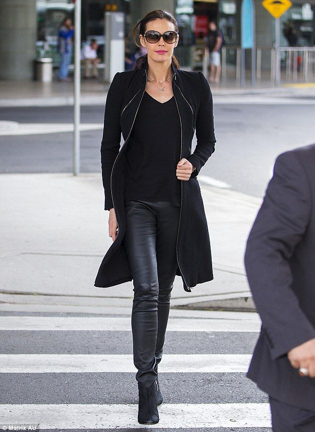 Making a statement:Megan Gale flaunted her flawless beauty as she strutted through Sydney Airport on Friday while showing off her long model legs in a pair of black leather tights
