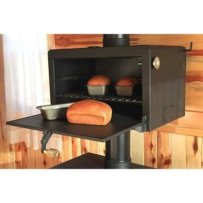 Baker's Salute Oven - Unique, steel convection oven attaches to 6 inch pipe on wood or coal burning stove – mounts above saving floor space. Heats from stove's exhaust which is contained in an air-tight jacket, then exits through your chimney. Side handle adjusts the circulation of the air; includes waterproof and ovenproof thermometer to monitor temperature. via Lehman's