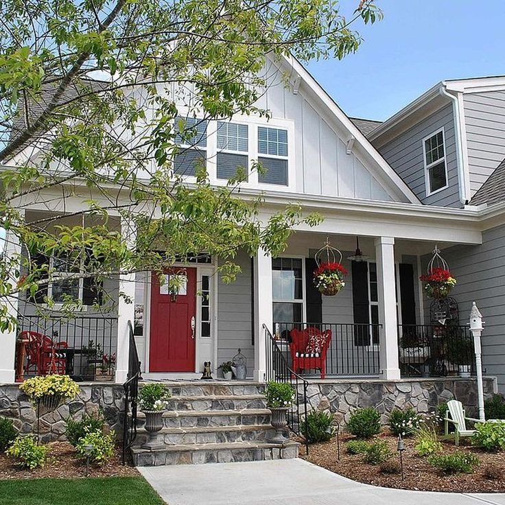 Farmhouse Style Front Porch With Pops of Red