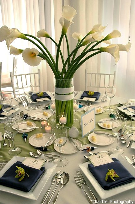 Navy,white, and bright green accents. Cylinder vases filled with South American calla lilies,banded in white grosgrain ribbon... Clean,modern centerpieces