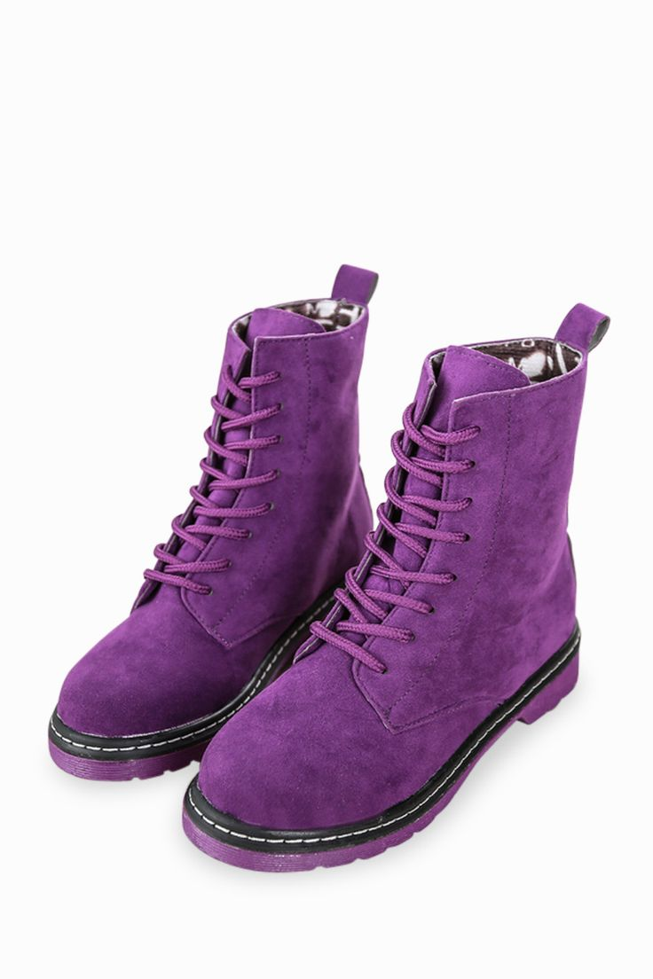 This item is shipped in 48 hours, included the weekends. These classic high top boots in purple are sure to easily complement all of your everyday wear. Featuring a lace up front, thick rubber soles a