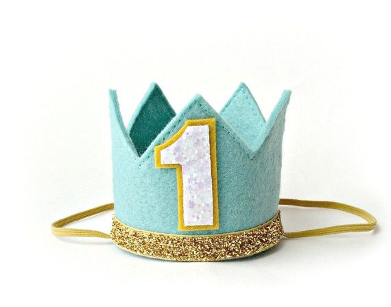 Medium aqua felt crown with gold trim, with or without a white number. Crown measures 2.75 high and 3 wide.  Select from the dropdown if you