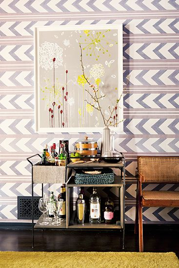 purple herringbone wallpaper, abstract artwork and vintage bar cart // bars