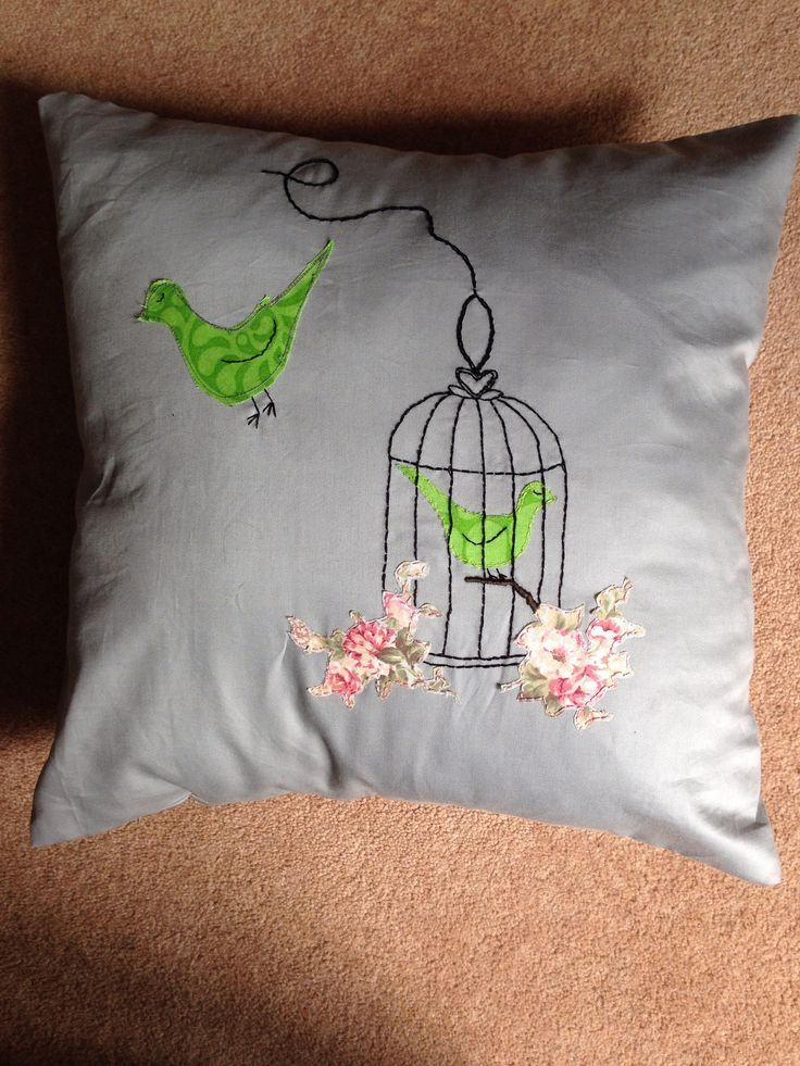 Hand embroidered birdcage cushion