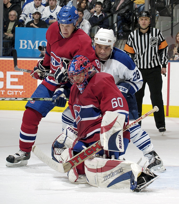 """Jose Theodore holds his ground in the Montreal net as Michael Ryder and Tie Domi fight for position in behind"" - DENNIS MILES PHOTOGRAPHY"